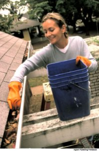 woman-cleaning-gutters